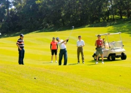 People playing golf during corporate team building event